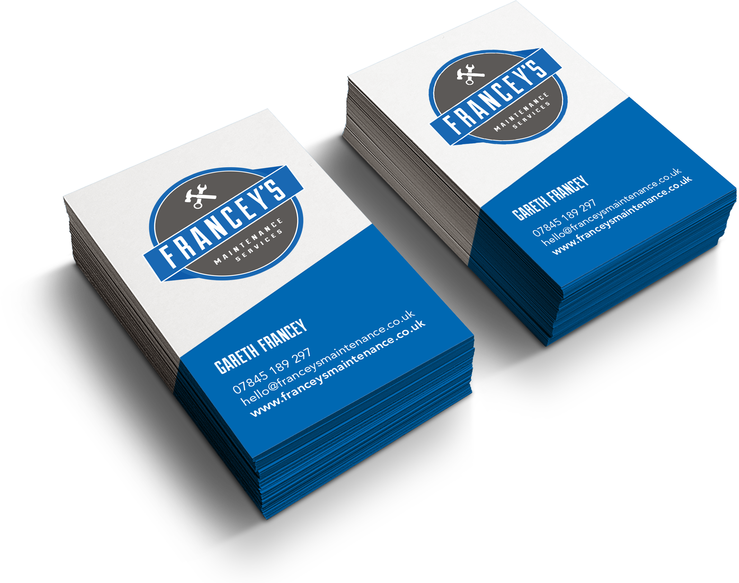 Stack of blue and white business cards with Francey's Maintenance logo and contact details