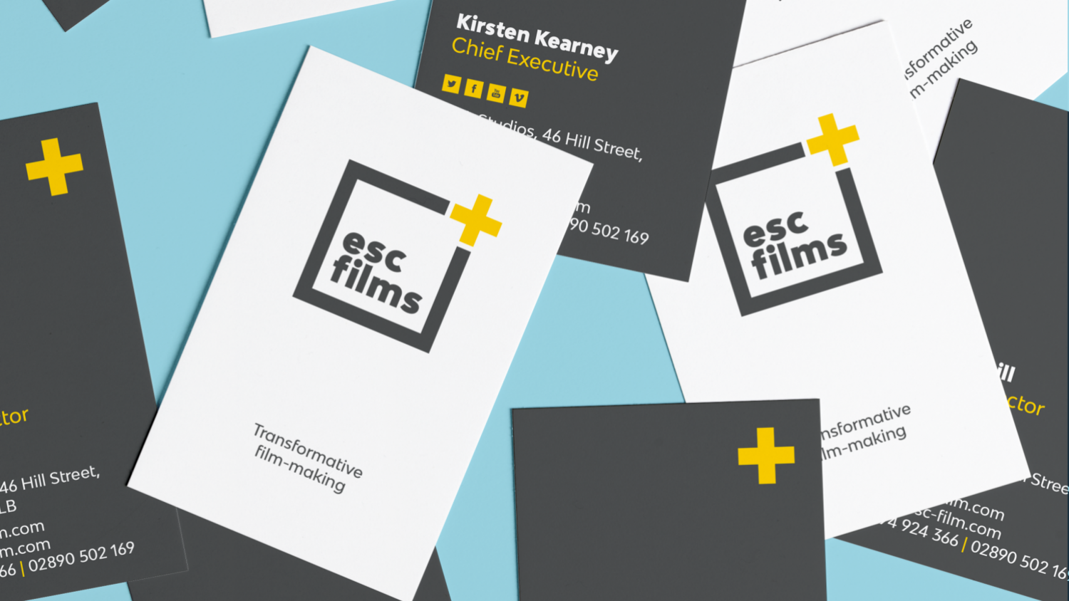 lots of grey and white business cards scattered on blue background with esc films logo and details