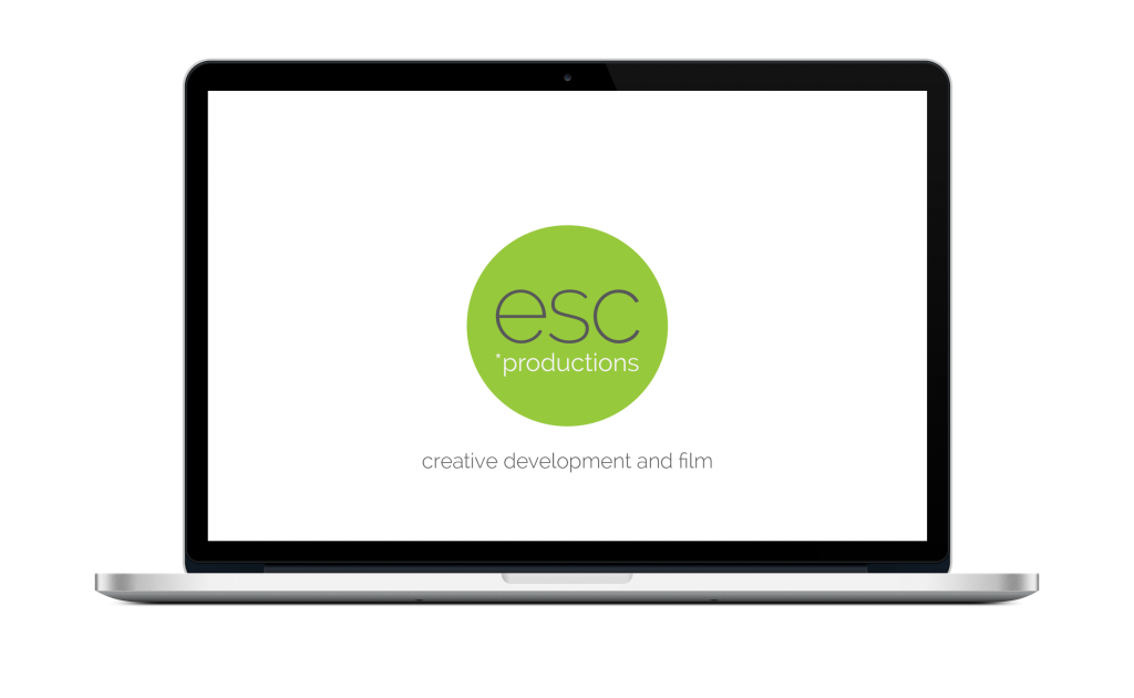 laptop with esc productions logo in green circle