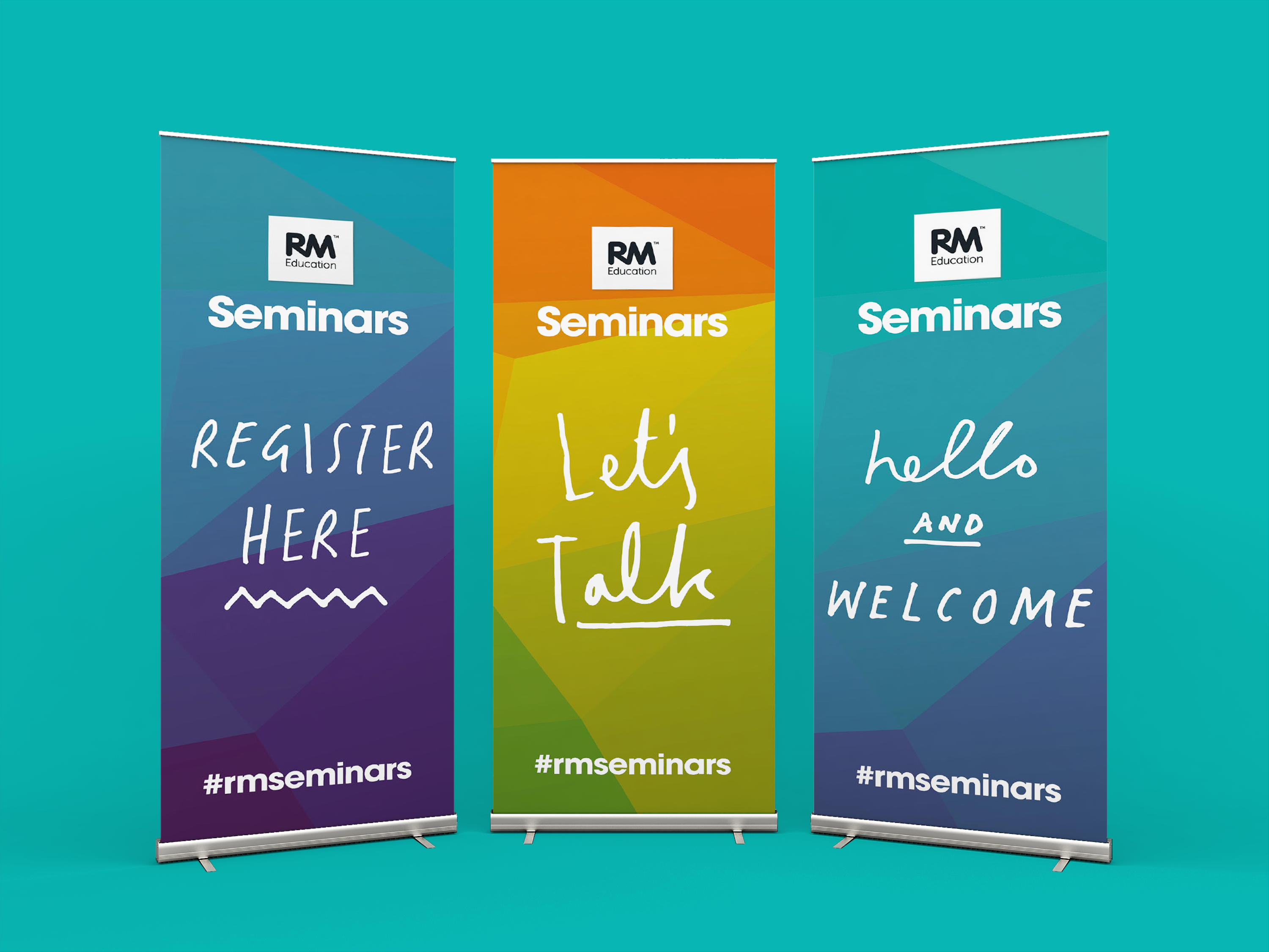 Three roll up banners with colourful background graphics saying 'Register here', 'Let's Talk' and 'Hellow and Welcome' all with RM Seminars logo.