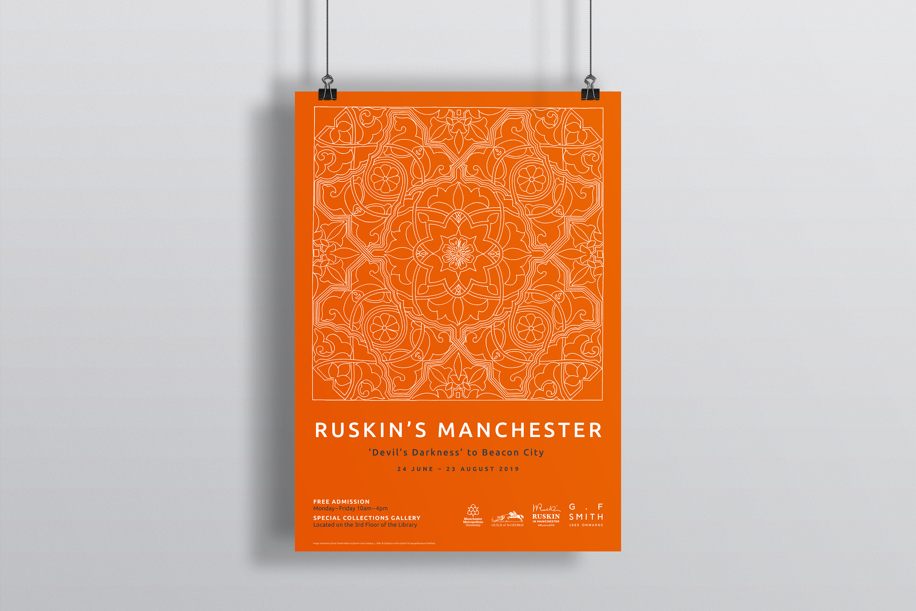 Orange poster with white pattern advertising ruskin's manchester exhibition, help up with string and bulldog clips