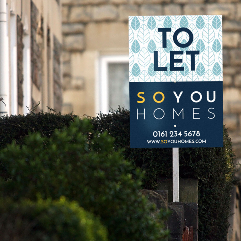 So You Homes To Let Sign with patterned background, infront of house surrounded with bushes